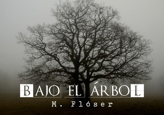 En el centro de la imagen y casi ocupándola por completo, vemos un roble con las ramas desnudas. Está en un valle nublado. El título del relato es: Bajo el árbol.