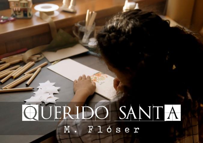 Niña de espaldas, sentada, está escribiendo la carta a Santa Claus. El relato se titula: Querido Santa.